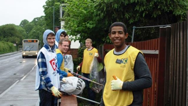 Coventry congregation members clean up the streets of Warwick