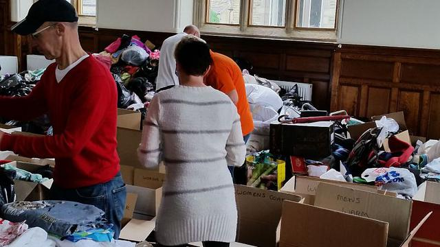 Huddersfield members sort through collections for Europe refugees