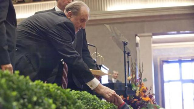 President Monson shakes a young man's hand at conference