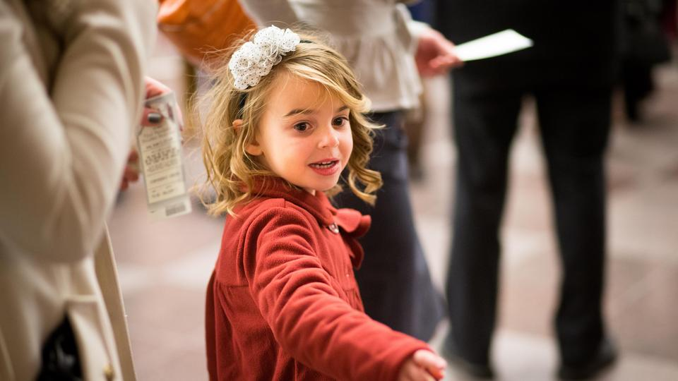 A young Latter-day Saint girl is one of thousands who attended the annual First Presidency Christmas Devotional in the Conference Center