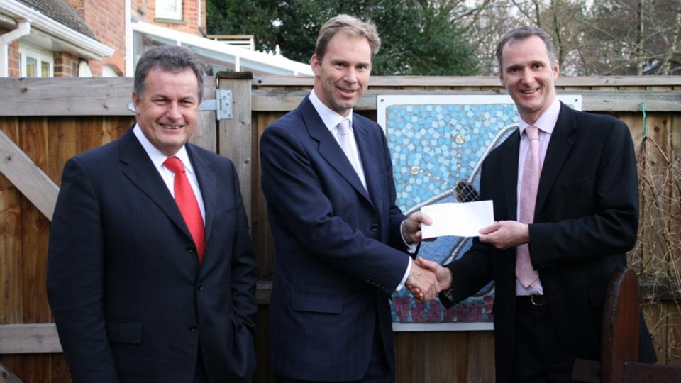 Poole Church leader, John Crew, with MP Tobias Ellwood and CEO of Julia's House, Martin Edwards
