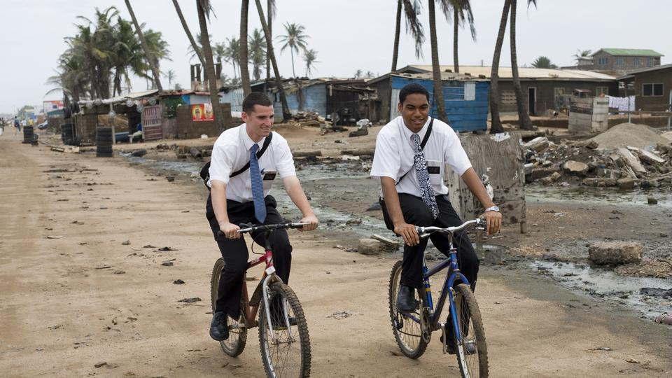 Missionaries riding their bikes