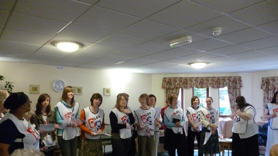 Women from the Northampton congregations sing for residents of Argyll House over the Jubilee Weekend