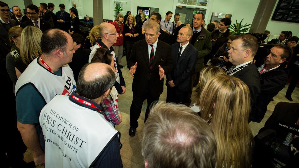 HRH Prince Andrew enages with Mormon Helping Hands volunteers in York